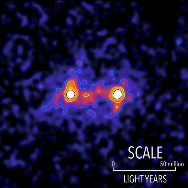 Dark matter filaments bridge the space between galaxies in this false colour map. The lbright galaxies are shown ‌in white and the presence of a dark matter filament bridging is shown in red. (S. Epps & M. Hudson/University of Waterloo)