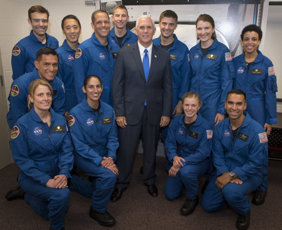 On June 7, 2017, U.S. Vice President Mike Pence is seen here with NASA's 12 new astronaut candidates at NASA's Johnson Space Center in Houston, Texas. NASA waded through its biggest applicant pool ever to select seven men and five women for its astronaut corps. (NASA via AP)