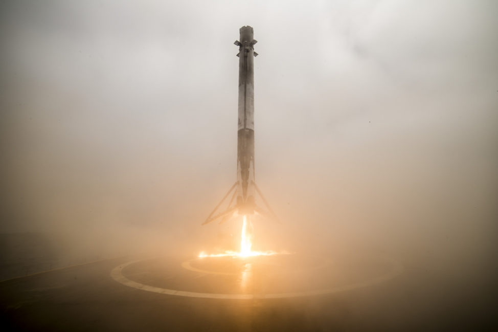 "After launching the Iridium-2 mission on June 25, 2017, the first stage of the SpaceX Falcon 9 is seen here returning and coming in for a landing on the ""Just Read the Instructions"" droneship that was positioned in the Pacific Ocean. (SpaceX, Flickr/Creative Commons)"