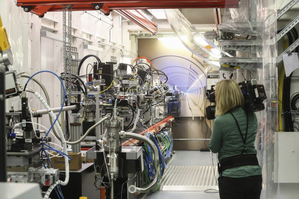 "A camerawoman is seen here, on September 1st, filming the so-called ""experimenting hut"" during the official inauguration of the giant European X-ray free-electron laser (European XFEL) in Germany. (Ulrich Perrey/dpa via AP)"