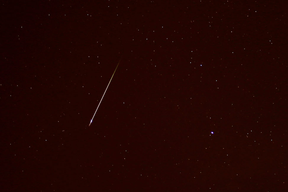 In a photo taken 10/22/17, near Malaga, Spain, a meteor is seen streaking past the constellation Canis Minor during the annual Orionid meteor showers. (Reuters)