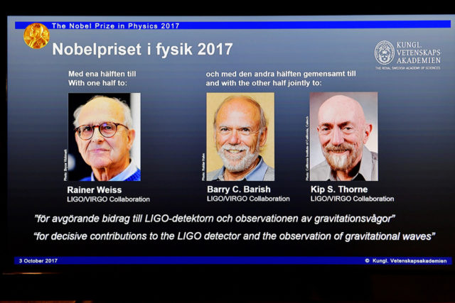 The names of Rainer Weiss, Barry C. Barish and Kip S. Thorne are displayed on the screen during the announcement of the winners of the Nobel Prize in Physics 2017, in Stockholm, Sweden, October 3, 2017. (TT News Agency/Jessica Gow via REUTERS)