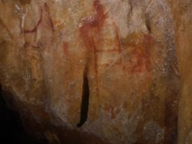Panel 78 in La Pasiega. The scalariform (ladder shape) composed of red horizontal and vertical lines dates to older than 64,000 years and was made by Neanderthals. (C.D Standish, A.W.G. Pike and D.L. Hoffmann)
