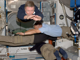 Four members of the joint STS-135/Expedition 28 crews are able to spend part of their last shared time onboard the International Space Station performing floating exercises that can't be done in Earth's gravity. Inside the Harmony Node 2 module, are NASA astronauts Mike Fossum (top), Expedition 28 flight engineer, and Doug Hurley, STS-135 pilot; and Ron Garan, Expedition 28 flight engineer. The crew member at bottom is partially obscured and is unidentified. (NASA)