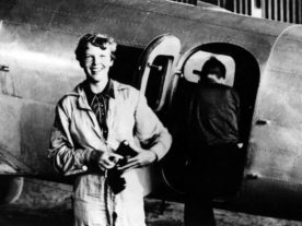 In a photo that is thought to have been taken on June 6, 1937 at Parnamerim airfield, Natal, Brazil, is American aviator Amelia Earhart standing by her Lockheed Electra. Her flight navigator, Fred Noonan, can be seen getting into the plane in the background. (Flickr's the Commons)