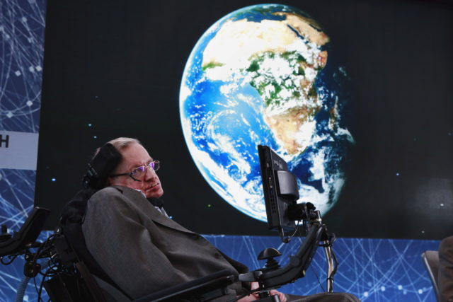 Stephen Hawking sits on stage during an announcement of the Breakthrough Starshot initiative with investor Yuri Milner in New York April 12, 2016. (REUTERS/Lucas Jackson)