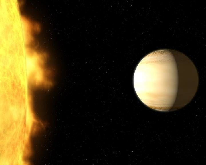 Sitting next to its parent star, this the Saturn-mass exoplanet WASP-39b, about 700 light-years from Earth. (NASA, ESA, and G. Bacon (STScI))