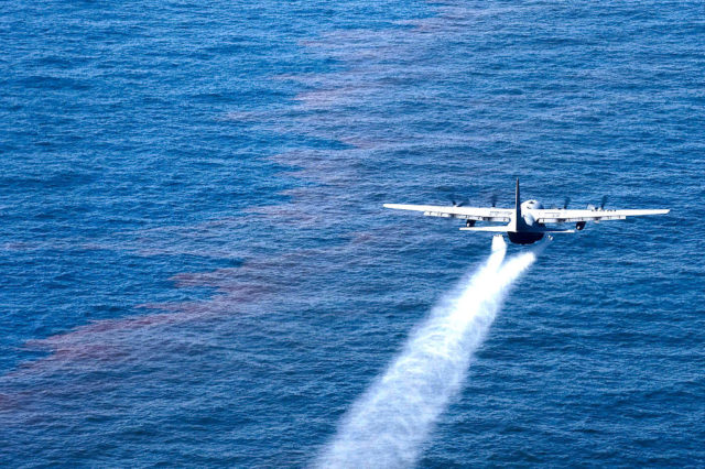 A C-130 Hercules from the Air Force Reserve Command's 910th Airlift Wing at Youngstown-Warren Air Reserve Station, Ohio, drops an oil-dispersing chemical into the Gulf of Mexico May 5, 2010, as part of the Deepwater Horizon Response effort. (Technical Sergeant Adrian Cadiz/US Air Force)
