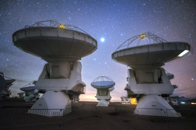 Night Photo of a couple of ALMA atennae (Yuri Beletsky/ESO)