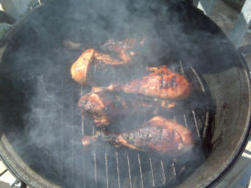 Turkey legs smoking on a barbeque grill. (Bart Everson/Creative Commons Attribution 2.0 Generic via Flickr)