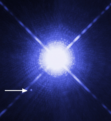Image of Sirius A and Sirius B taken by the Hubble Space Telescope. Sirius B, which is a white dwarf, can be seen as a faint point of light to the lower left of the much brighter Sirius A. (NASA)
