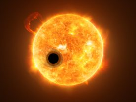 Artist rendering of the exoplanet WASP-107b transiting its highly active K-type main sequence star. (ESA/Hubble, NASA, M. Kornmesser)