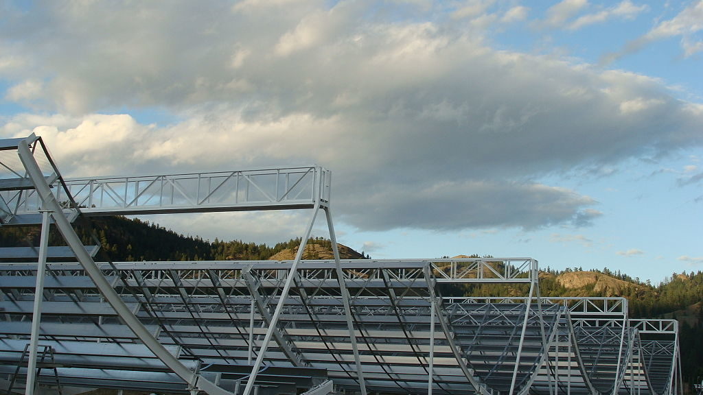 The Canadian Hydrogen Intensity Mapping Experiment, (CHIME) in 2015, during construction of the parabolic trough reflector at the Dominion Radio Astrophysical Observatory in British Columbia, Canada. (Mateus A. Fandiño/Creative Commons BY-SA 4.0 via Wikimedia Commons)