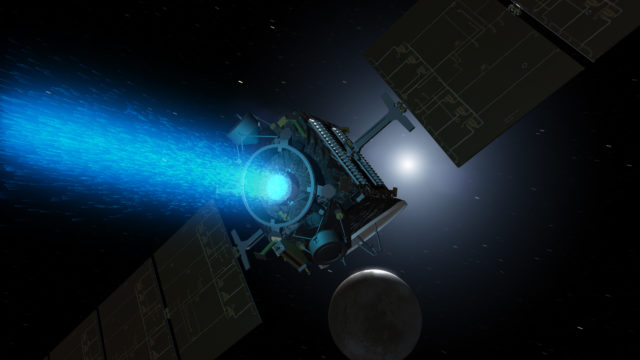 This artist's concept shows NASA's Dawn spacecraft arriving at the dwarf planet Ceres (lower right). (NASA/JPL-Caltech)