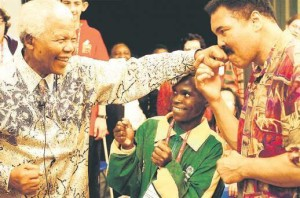 Nelson Mandela spars playfully with Muhammad Ali