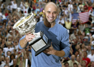 Andre Agassi lifts the Australian Open trophy for a fourth time in 2003. Photo: Reuters