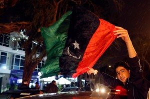 A young man waves the Libyan flag in Benghazi after the country won this year's African Nations Championship football tournament. Photo: Reuters