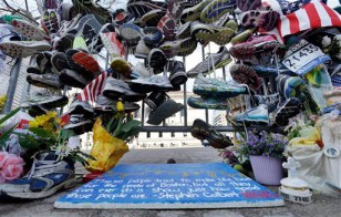 Running shoes memorial near finish line of 2013 Boston Marathon
