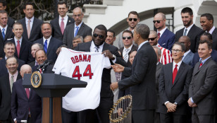 "Red Sox slugger David ""Big Papi"" Ortiz presents a team jersey to President Obama. Photo: AP"