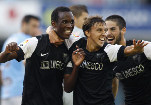 Fabrice Olinga with his Malaga teammates in 2012. Photo: Reuters