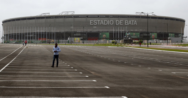 A man walks in front of the Estadio de Bata in Bata (Reuters)