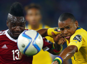Thievy Bifouma of Congo is challenged by Gabon's Johann Obiang during their Group A soccer match of the 2015 African Cup of Nations in Bata