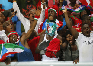 Equatorial Guinea fans celebrate after winning the Group A soccer match against Gabon in the African Cup of Nations in Bata