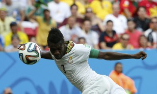 Ghana's Gyan heads to score against Portugal during their 2014 World Cup Group G soccer match at the Brasilia national stadium in Brasilia