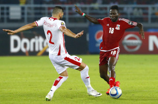 Tunisia's Syam Ben Youssef challenges Equatorial Guinea's Wahbi Khazri iduring their quarter-final soccer match of the 2015 African Cup of Nations in Bata