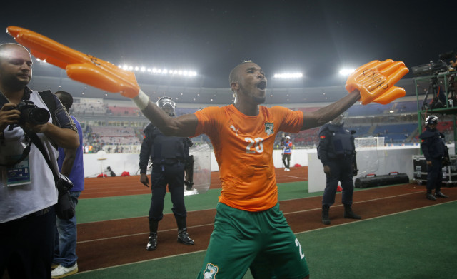 Ivory Coast's Die Serey celebrates with fans after winning their semi-final soccer match of the 2015 African Cup of Nations against Democratic Republic of Congo in Bata