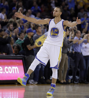 Stephen Curry celebrates another basket. Photo: AP
