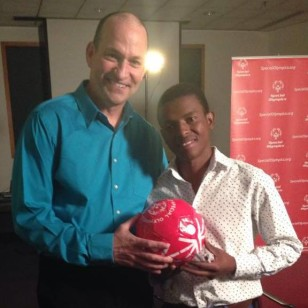 Sonny and Bright hold a Special Olympics soccer ball.