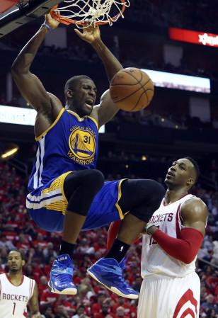 Festus Ezeli dunks over Houston Rockets center Dwight Howard. Photo:  Troy Taormina-USA TODAY Sports