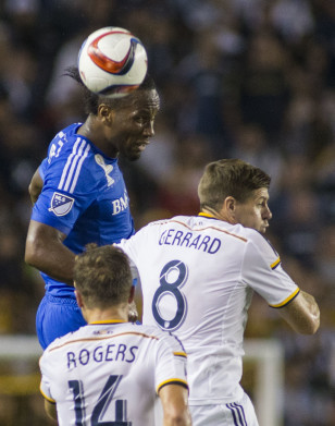 Didier Drogba in action against British star Steven Gerrard of the Los Angeles Galaxy, another international player in his first MLS season. Photo: Ringo H.W. Chiu / AP