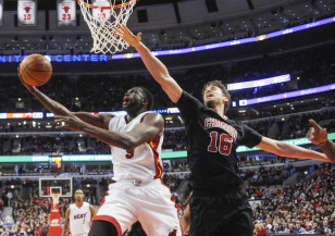 Miami's Luol Deng puts up a shot during a game against the Chicago Bulls, his former club. Photo: David Banks-USA TODAY Sports