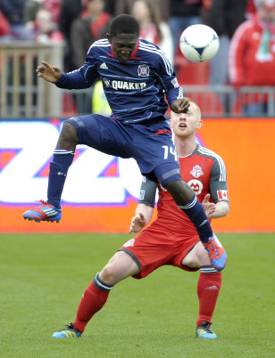Patrick Nyarko leaps for the ball while playing for the Chicago Fire. Photo: Mike Cassese/Reuters