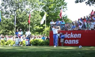 Ernie Els begins play at the first tee during the final round of the Quicken Loans National at the Congressional Country Club in Bethesda, Maryland. (photo by Bill Workinger / Voice of America)