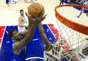 Joel Embiid goes up for a rebound. Photo: Chris Szagola / Associated Press