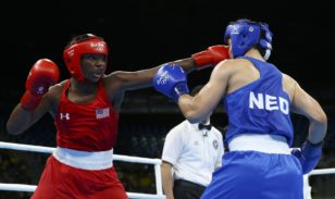 Claressa Shields (L) lands a punch against Dutch opponent Nouchka Fontijn in the Olympic women's middleweight final in Rio. Photo: Peter Cziborra / Reuters