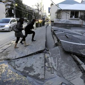 Japan's massive 8.9-magnitude earthquake collapsed a pedestrian road in Urayasu city, Chiba prefecture, Japan, March 11, 2011.  (Photo: AFP)