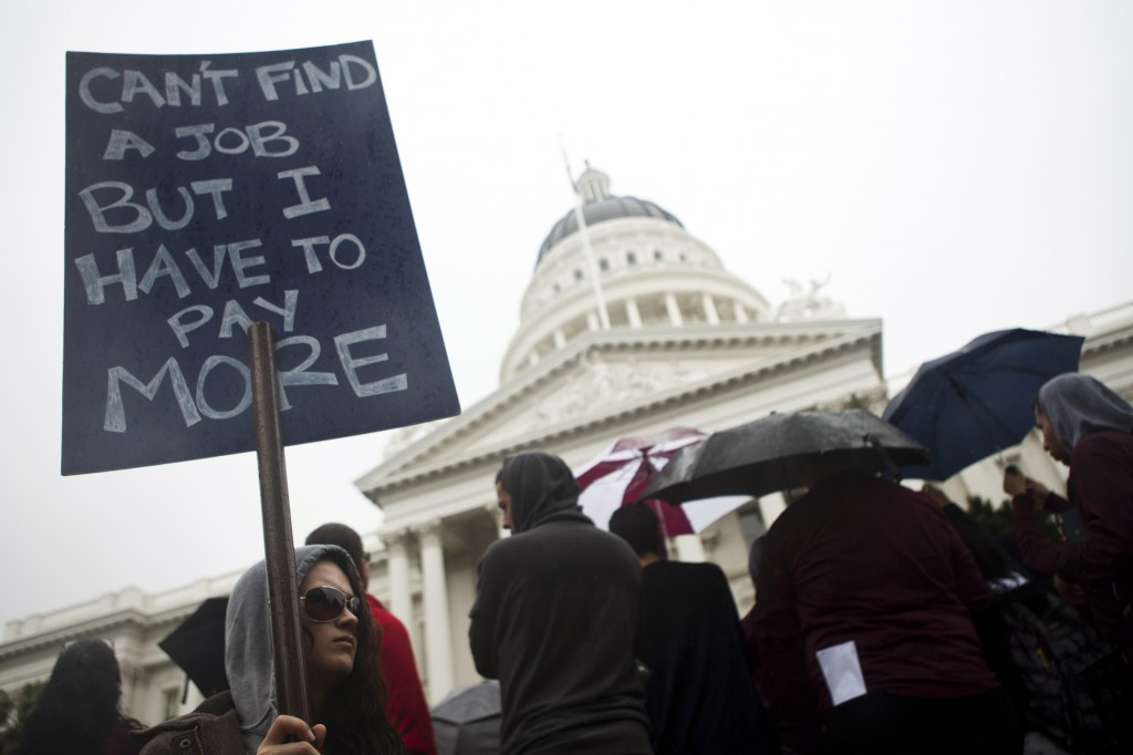 College students and faculty protest at the State Capitol in Sacramento, California (Photo: REUTERS/Max Whittaker)