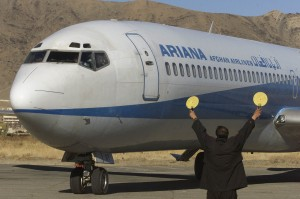A technician directs an Ariana Afghan airlines Boeing 727-200 before take off at Kabul's airport on January 16, 2002. The first plane took off, made a circle and landed again at Kabul's civilian airport, officially opened on Wednesday, after being renovated by British military engineers. REUTERS/Oleg Popov  OP/CLH/