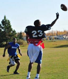 In real football the players tackle each other to the ground. Flag football's a bit kinder - you grab one of those flags hanging from the player's belt (Creative Commons photo by Fort Wainwright Public Affairs Office on Flickr)