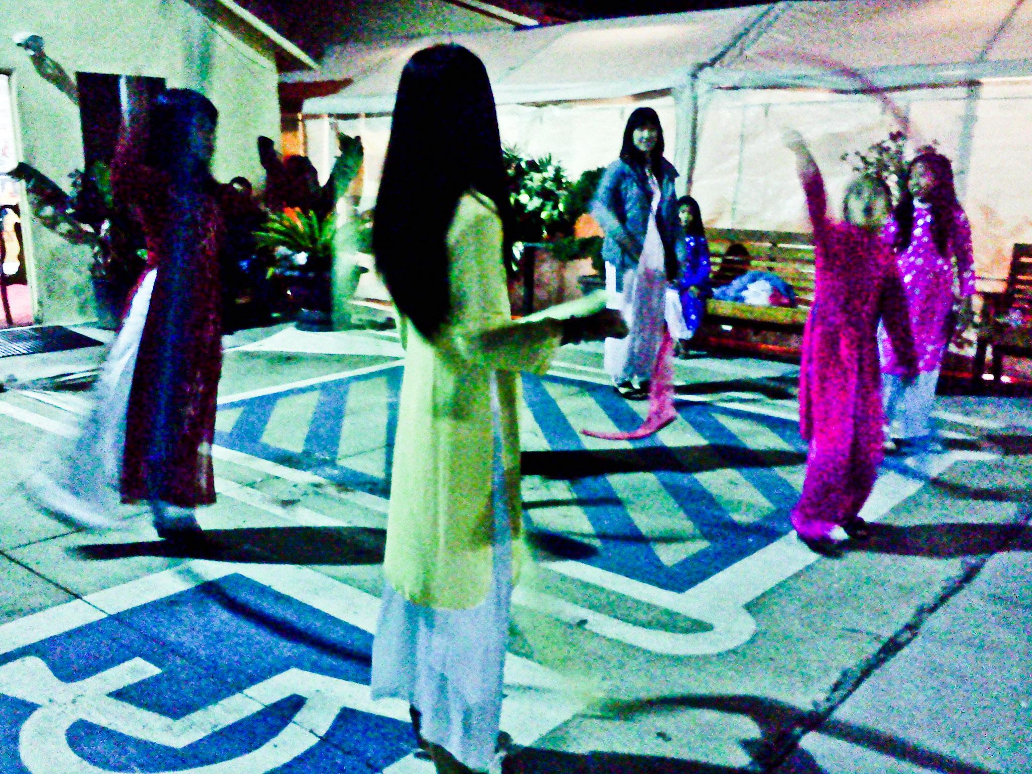 "Vietnamese American kids, in Vietnamese custom ""Ao Dai"", were practicing silk-dance for TET festival"
