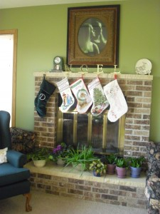 "Christmas stockings hung on the fireplace. Mine's the giant green one that says ""D"" for Dandan."