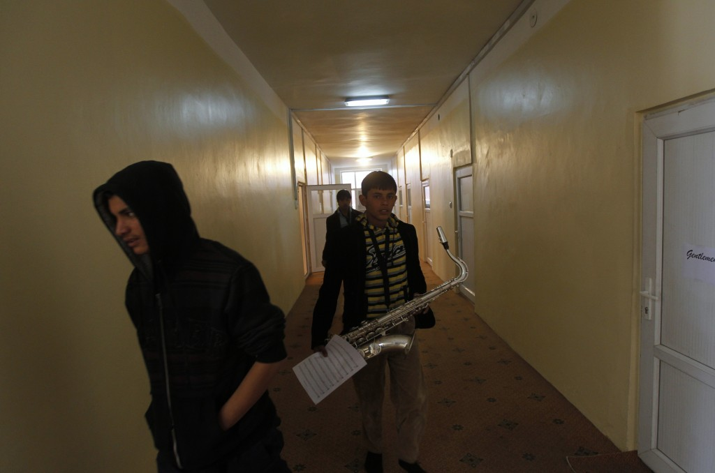 A student carrying a saxophone and some sheet music walks along a corridor at the Kabul Music Academy January 7, 2012 (Photo: Reuters)