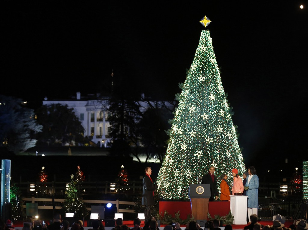 The Obama family lights the 2012 National Christmas Tree, along with Neil Patrick Harris (Photo: Reuters)