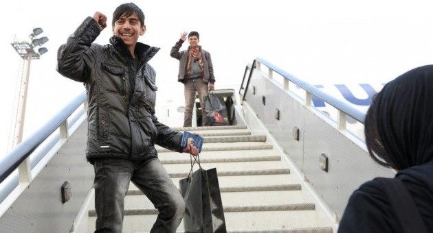 Fawad Mohammadi, star of the short film Buzkashi Boys, boards a plane bound for Los Angeles and the Academy Awards. Co-star Jawanmard Paiz is in the background. (Photo: US Embassy Kabul)