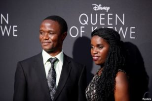 "Robert Katende (L) and Phiona Mutesi (R), at ""Queen of Katwe"" premiere in Hollywood, California, Sept. 20, 2016."