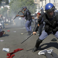 Students run for cover as police fire stun grenades and rubber bullets in an attempt to disperse them, during their protest for free education in Johannesburg, South Africa, Wednesday, Sept. 21, 2016. A leading university in South Africa has closed for the rest of the week because of violence by protesters demanding free education across the country. (AP Photo/Themba Hadebe)